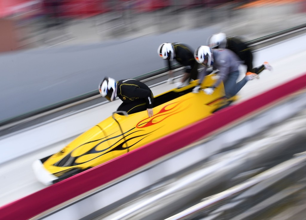 Pilot Nico Walther of Germany leads his team at the start of the four-man bobsleigh training session. MARK RALSTON/AFP/Getty Images