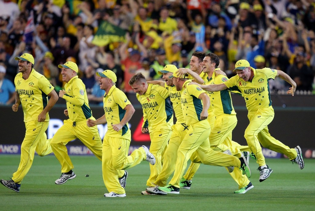 Australian players celebrate after they defeated New Zealand by seven wickets to win the Cricket World Cup final, in Melbourne, Sunday. AP Photo/Rob Griffith