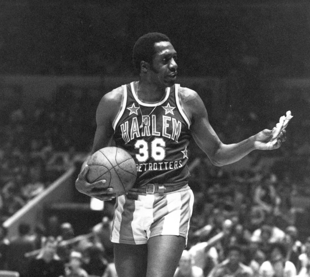 Meadowlark Lemon of the Harlem Globetrotters offers a pretzel to a referee during a game at Madison Square Garden, Feb. 18, 1978. AP Photo/Suzanne Vlamis
