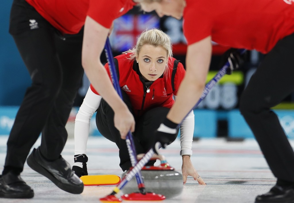 Anna Sloan of Britain delivers a stone during curling match against Japan. REUTERS/Cathal McNaughton