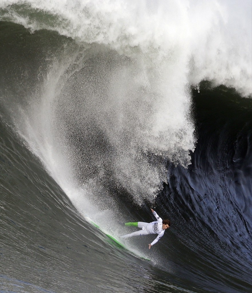 Nic Lamb begins to fall off his board during the third heat of the first round of the Mavericks Invitational Friday at Half Moon Bay, California. AP Photo/Eric Risberg