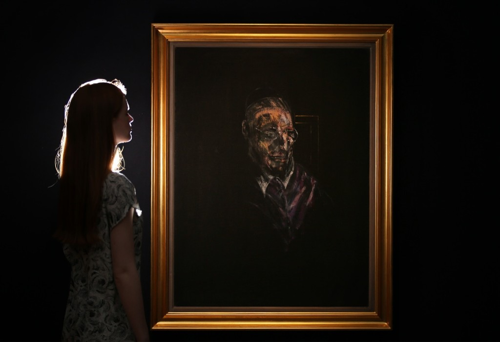 A Christie's employee looks at Francis Bacon's 'Study for a Head' in London. Peter Macdiarmid/Getty Images