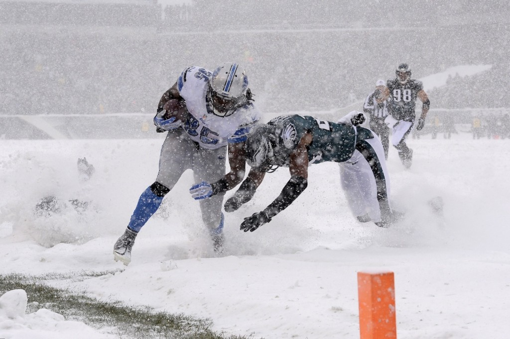 Lions' Joique Bell is tackled by Eagles' Bradley Fletcher during first half. AP Photo/Michael Perez