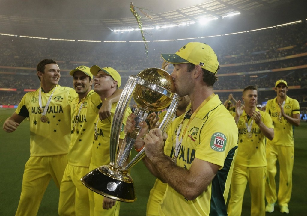 Australia's Glenn Maxwell kisses the Cricket World Cup trophy after they defeated New Zealand in the final match, in Melbourne, Sunday. REUTERS/Hamish Blair
