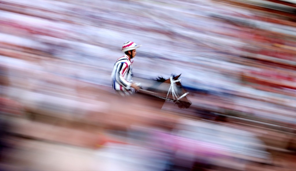"Jockey Elias Mannucci of ""Istrice"" parish rides his horse during the first practice for the Palio horse race in Siena, Italy. REUTERS/Stefano Rellandini"