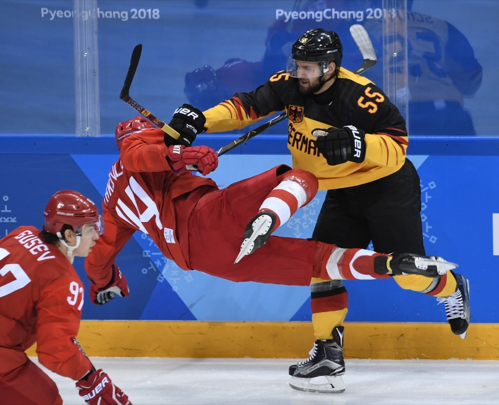 Germany's Felix Schutz and Russia's Yegor Yakovlev clash in the men's gold medal ice hockey game. JUNG YEON-JE/AFP/Getty Images