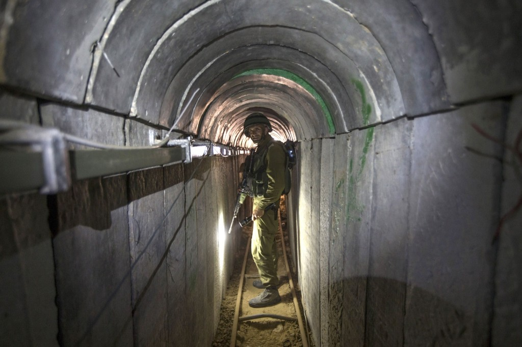 An Israeli army officer in a tunnel said to be used by Palestinian militants from the Gaza Strip for cross-border attacks. JACK GUEZ/AFP/Getty Images