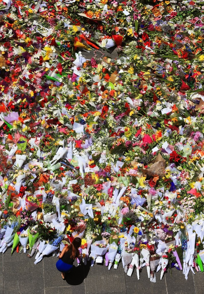 Sydneysiders lay flowers for victims Tori Johnson and Katrina Dawson at the scene of the Martin Place siege in Sydney. Toby Zerna/Newspix/Getty Images