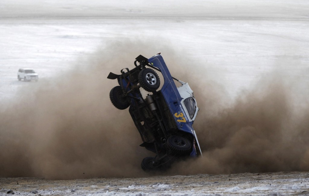 A car overturns during the Master Cross Race 2014 at Suuj Uul, outside Ulan Bator. REUTERS/B. Rentsendorj