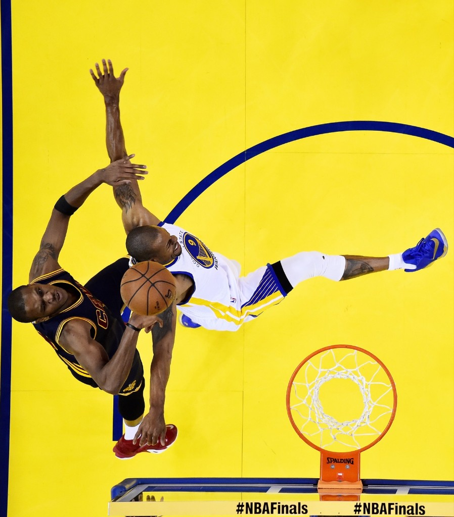 Andre Iguodala of the Warriors goes up against James Jones. John G. Mabanglo-Pool/Getty Images