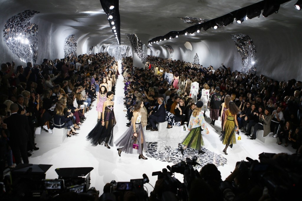 Models wear creations for the Christian Dior Spring/Summer 2018 ready-to-wear fashion collection. AP Photo/Francois Mori