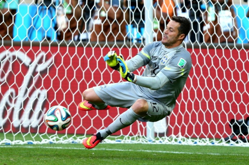 Julio Cesar of Brazil saves a penalty kick from Mauricio Pinilla of Chile. Ryan Pierse/FIFA/Getty Images