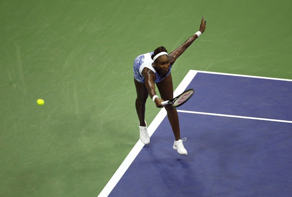 Venus Williams of the U.S. is aced on a serve from her sister Serena Williams at the U.S. Open tennis tournament in New York, Tuesday. Gary Hershorn/Corbis