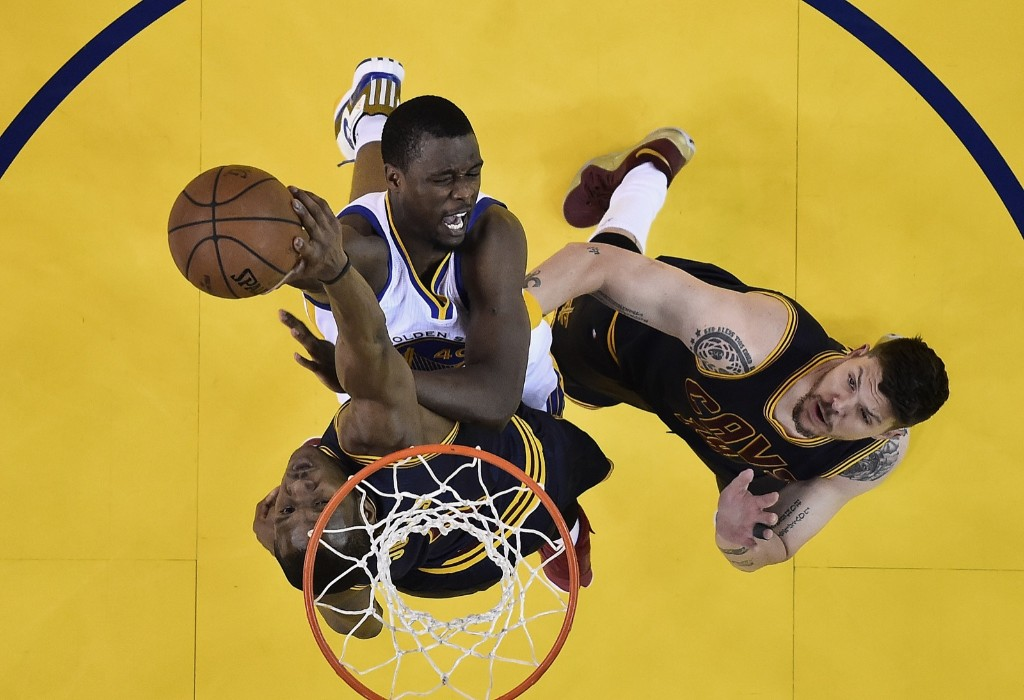Warriors Harrison Barnes shoots against Cavaliers James Jones, bottom, and Mike Miller during the first half. John G. Mabanglo/EPA Pool via AP