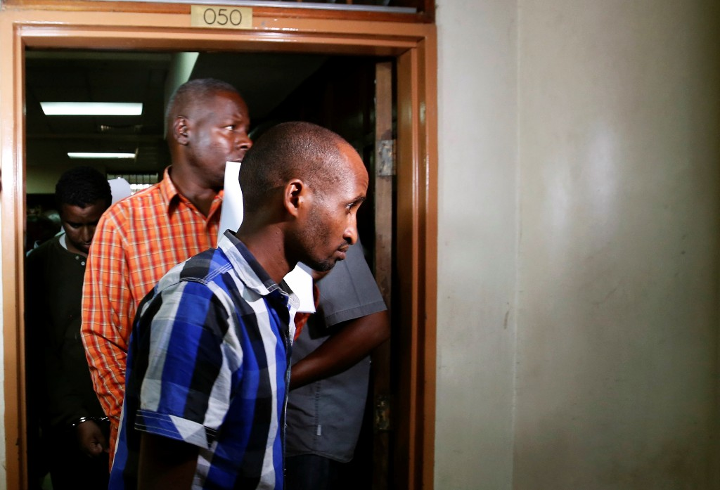 Osman Ibrahim and Oliver Muthee are escorted from the Mililani Law Courts where they appeared as suspects in connection with the attack at the DusitD2 complex, in Nairobi, Kenya January 18, 2019. REUTERS/Thomas Mukoya