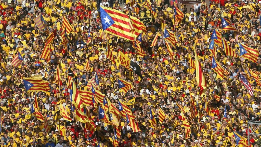 Catalan pro-independence demonstrators attend a rally in Barcelona. REUTERS/Albert Gea
