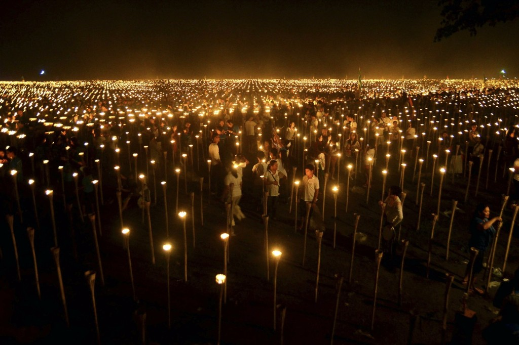 Volunteers light candles in Oton, central Philippines. The event achieved a Guinness world record for the largest candle-lit image with 56,690 candles forming the map of the Philippines. REUTERS/Leo Solinap