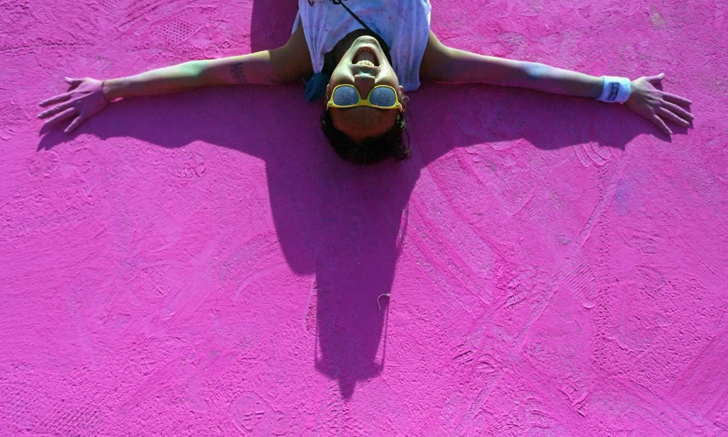 A competitor after crossing the finish line during the Color Run in Marseille. REUTERS/Jean-Paul Pelissier