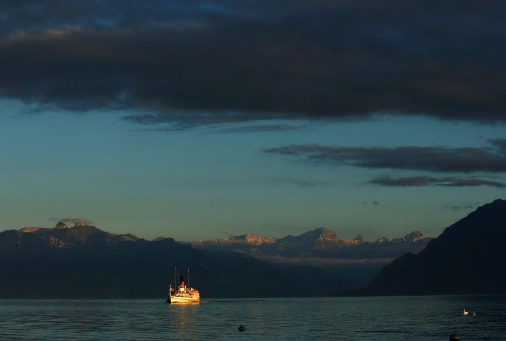 """La Suisse"" steamboat sails on Lake Leman during an autumn evening in Lausanne, Switzerland. REUTERS/Denis Balibouse"