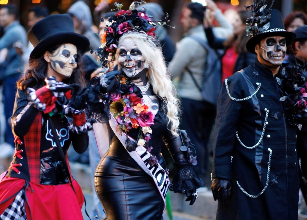 People participate in the Catrina parade ahead of the Day of the Dead in Mexico City. REUTERS/Andres Stapff