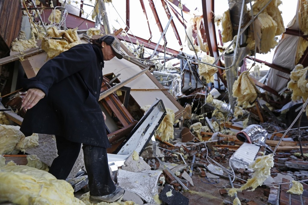 Sandra McDaniel walks through the remains of the showroom at Jack Morris Gas Company in Columbia, Miss., after a tornado ripped throught the town on Tuesday. AP Photo/Rogelio V. Solis