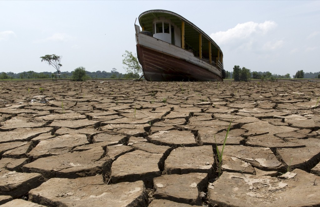 A boat lies on the bottom of Amazonas river in the city of Manaus, Brazil. A severe drought has pushed river levels in Brazil's Amazon region to new lows. REUTERS/Bruno Kelly