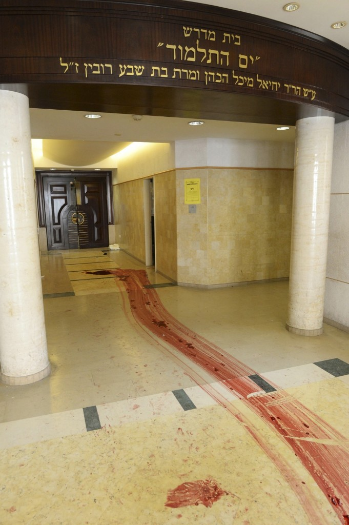 The blood-stained floor of a synagogue in Jerusalem after an attack by two Palestinians. Four rabbis were killed. AP Photo/Kobi Gideon/GPO
