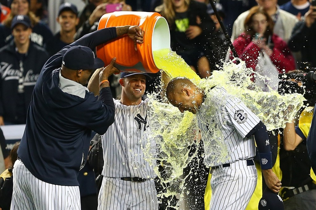 CC Sabathia and Brett Gardner dump Gatorade on Derek Jeter. Elsa/Getty Images