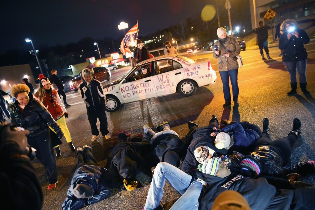 Demonstrators block an intersection during a protest in Ferguson. Scott Olson/Getty Images