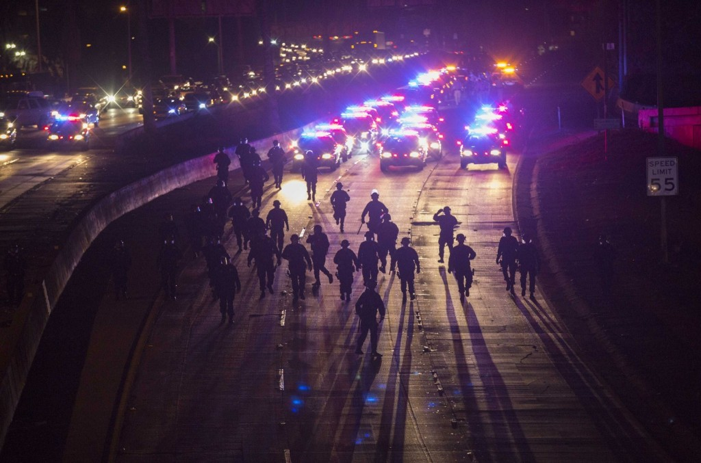 California Highway Patrol officers clearing the 101 freeway from protesters in Los Angeles after grand jury returned no indictment in the Ferguson, Mo. case. REUTERS/Mario Anzuoni