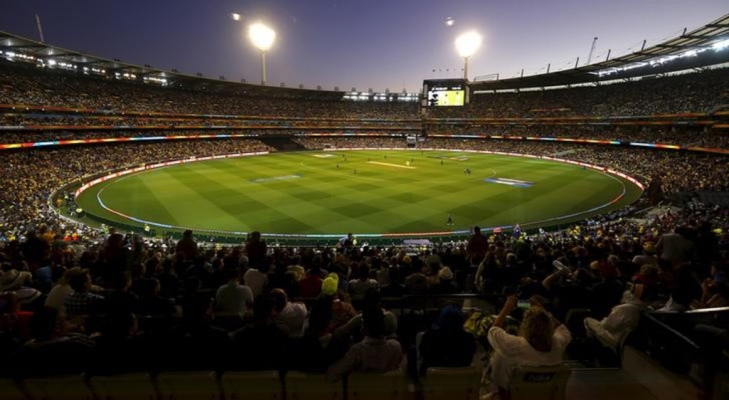 Members of the crowd watch as Australia and New Zealand play their Cricket World Cup final match at the Melbourne Cricket Ground, Snday. REUTERS/David Gray