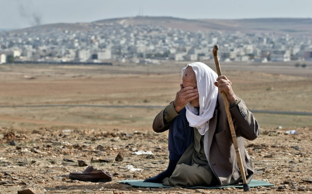 Syrian Kurdish refugee Mohammad Hassan, 84, from Kobani, on the outskirts of Suruc. AP Photo/Vadim Ghirda