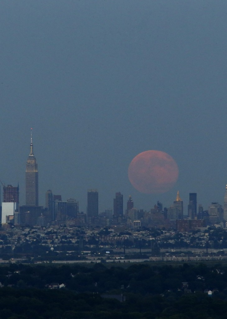 A Blue Moon rises over the skyline of New York City as seen from West Orange in New Jersey. KENA BETANCUR/AFP/Getty Images