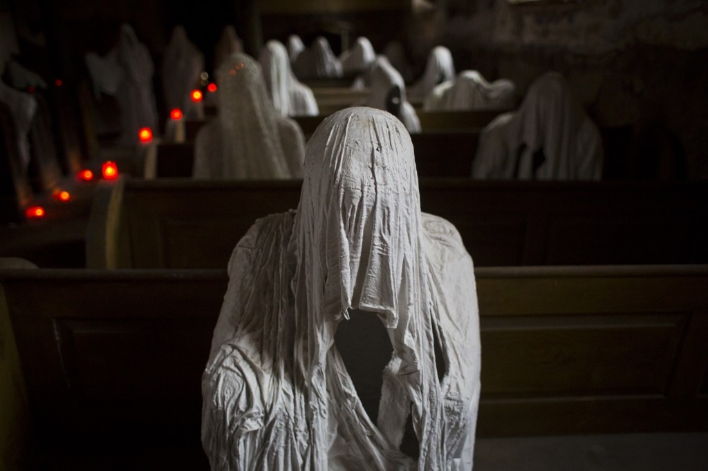 Ghost statues by artist Jakub Hadrava are placed at the St. George's church in Lukova, Czech Republic. Matej Divizna/Getty Images