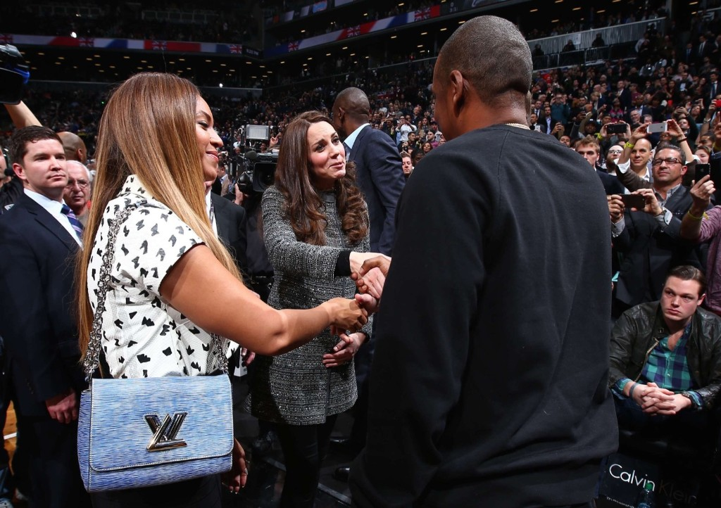 Catherine, Duchess of Cambridge, is greeted by recording artists Beyonce and Jay-Z as they attend the NBA basketball game between the Cleveland Cavaliers and the Brooklyn Nets in New York, Monday. REUTERS/NBAE/Handout