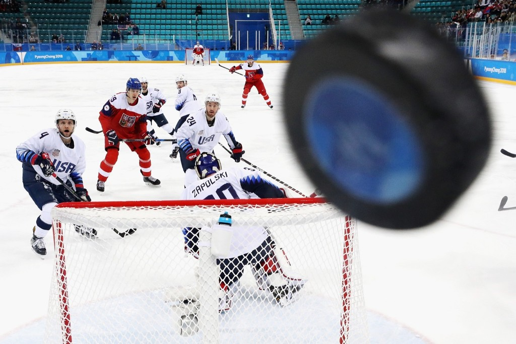 The puck hits the glass in the first period of quarterfinal game between the Czech Republic and the U.S. Ronald Martinez/Getty Images