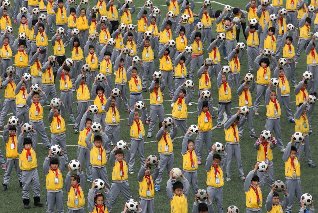 Students practice football calisthenics at a playground in Taipei. ChinaFotoPress/Getty Images
