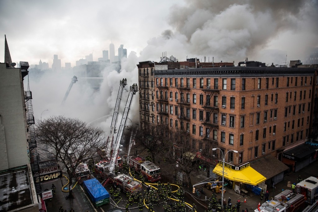 New York City Fire Department personel work to extinguish a fire after an explosion on 2nd Avenue in Manhattan's East Village. Andrew Burton/Getty Images