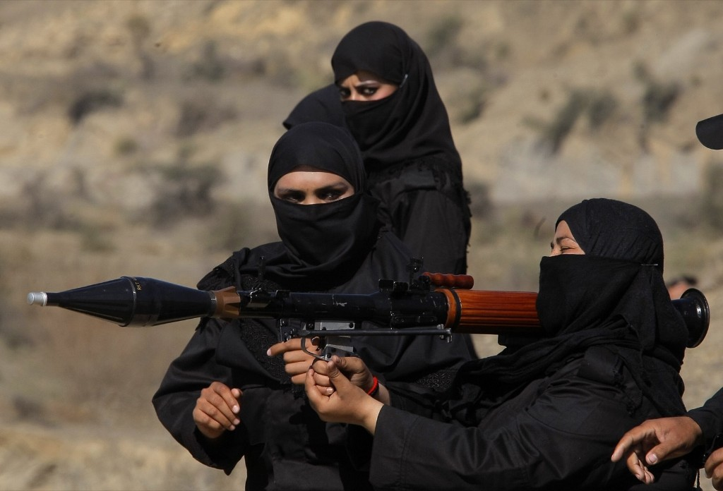 Pakistani female police commandos during training session in Nowshera, near Peshawar. AP Photo/Mohammad Sajjad