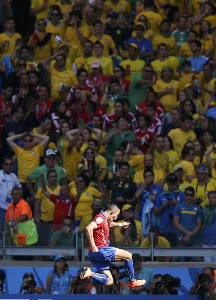 Chile's Alexis Sanchez after scoring a goal against Brazil. REUTERS/Toru Hanai