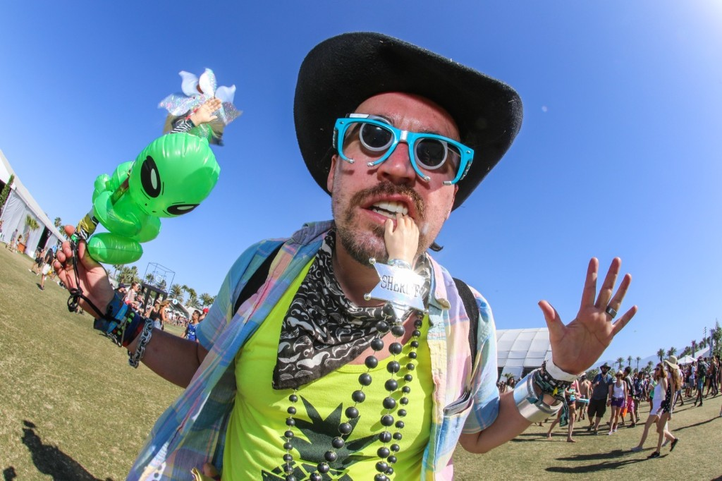 A festival goer walks through the Empire Polo Field on Sunday. Rich Fury/Invision/AP