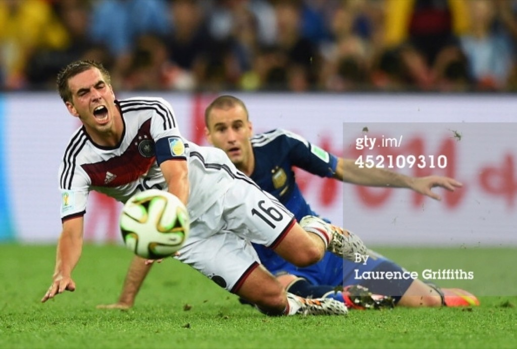 Philipp Lahm of Germany being challenged by Rodrigo Palacio of Argentina. Laurence Griffiths/Getty Images