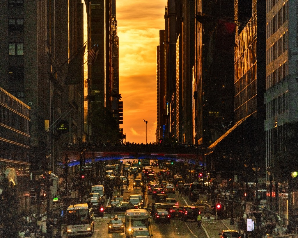 A cloud-obscured Manhattanhenge sunset as seen from 42nd Street in Manhattan. Michael Brochstein/SOPA Images/LightRocket via Getty Images
