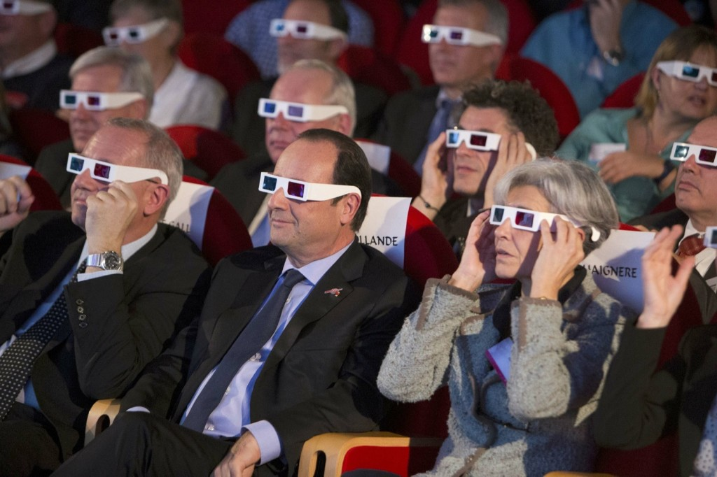Spectators wear 3D glasses at the Cite des Sciences at La Villette in Paris as they follow the successful landing of the Philae lander on comet 67P/ Churyumov-Gerasimenko. REUTERS/Jacques Brinon/Pool
