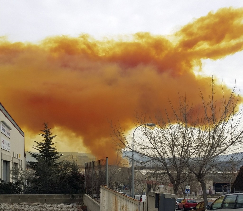An orange toxic cloud over the town of Igualada, near Barcelona, following an explosion in a chemical plant. REUTERS/Ricard Sole Figueras