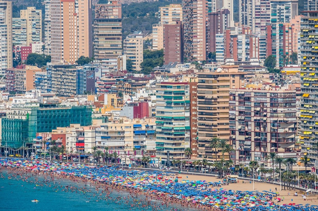 People sunbathe at Levante Beach in Benidorm, Spain. David Ramos/Getty Images