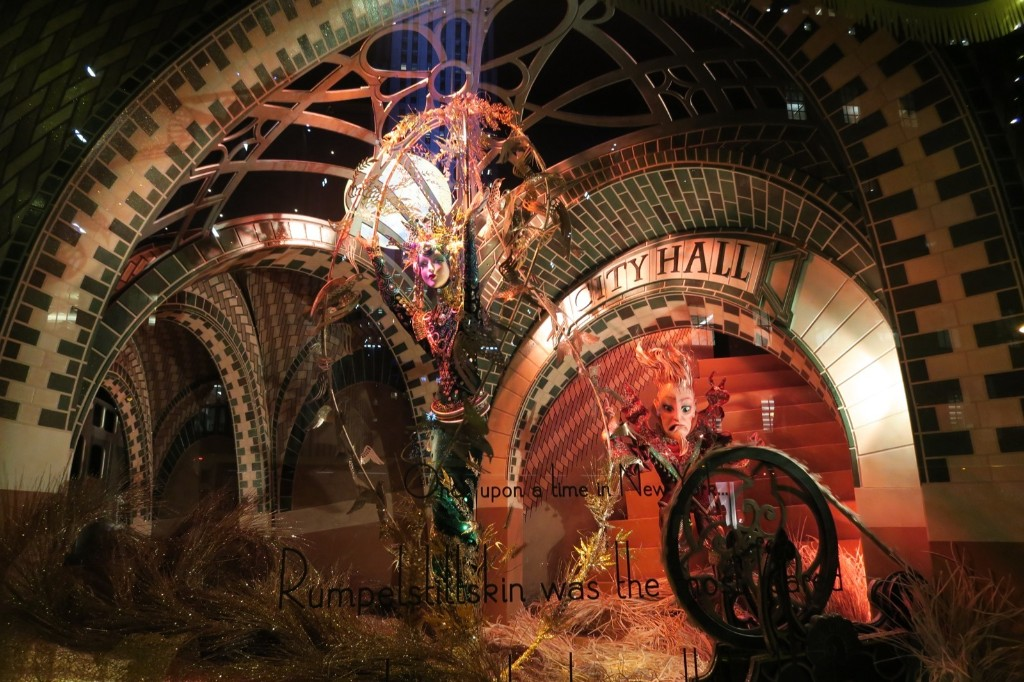 Saks Fifth Avenue created scenes from classic fairy tales with iconic New York locations providing the backdrop. This one shows Rumplestiltskin spinning straw into gold in a gloomy subway tunnel. Photo by Gary Hershorn