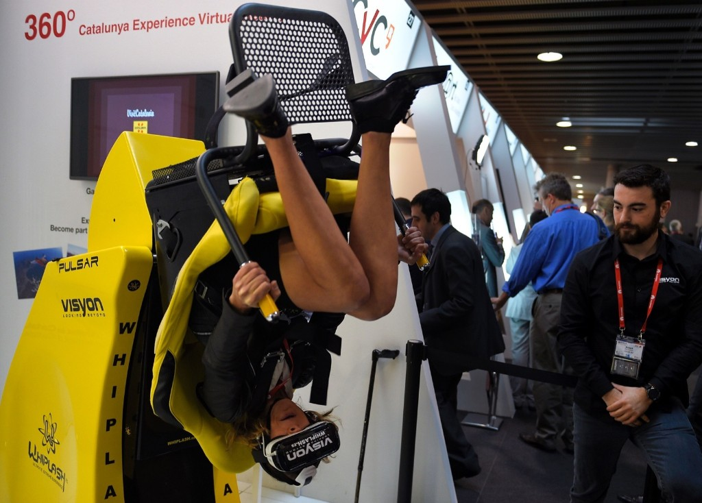 A woman tests the new 'Oculus VR' virtual device on the third day of the Mobile World Congress in Barcelona. LLUIS GENE/AFP/Getty Images