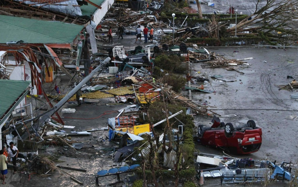 Debris litters a damaged airport. Possibly the strongest typhoon ever to hit land, Haiyan devastated the central Philippine city of Tacloban, killing at least 100 people. REUTERS/Erik De Castro