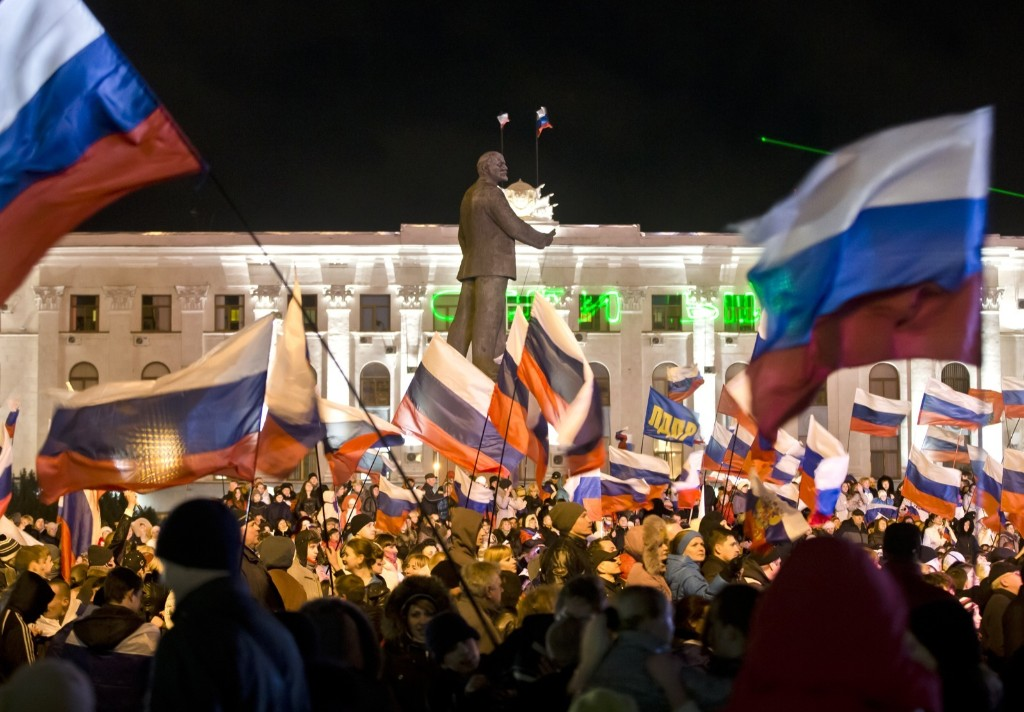 Pro-Russians celebrate in Simferopol's Lenin Square after a vote to have Crimea secede from Ukraine. AP Photo/Vadim Ghirda